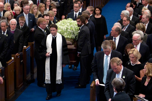 Reverend Brent Beasley leads the processional as the pallbearers carry the casket of Van Cliburn into Broadway Baptist Church in Fort Worth, Texas for his funeral on Sunday, March 3, 2013. (Star-Telegram / Joyce Marshalll)
