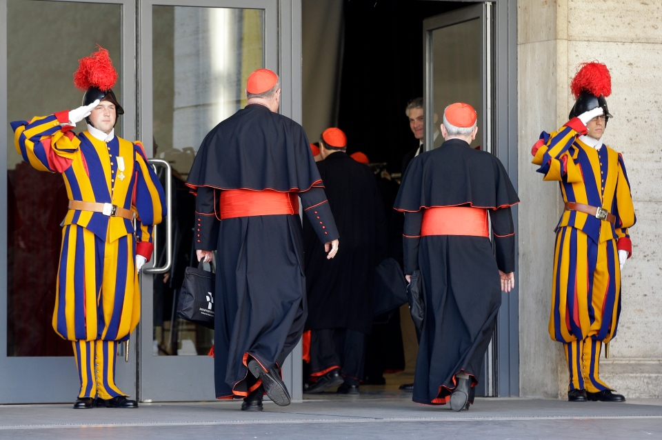 Vatican Swiss guards salute as cardinals arrive for a meeting, at the Vatican, Monday, March 4, 2013. (AP / Andrew Medichini)