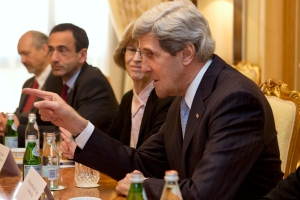 U.S. Secretary of State John Kerry, points toward Palestinian President Mahmoud Abbas, not pictured, during their last-minute meeting at the Ritz-Carlton Hotel in Riyadh, Saudi Arabia on Monday, March 4, 2013.(AP /Jacquelyn Martin)
