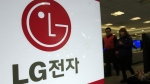 Shoppers walk by a logo of LG Electronics at a local electronic department store in Seoul, South Korea, Wednesday, Jan. 26, 2011. (AP Photo/Lee Jin-man)