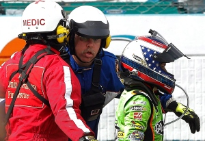 Danica Patrick heads to the infield medical centre after crashing during the NASCAR Sprint Cup Series auto race, Sunday, March 3, 2013, in Avondale, Ariz. (AP Photo/Matt York)