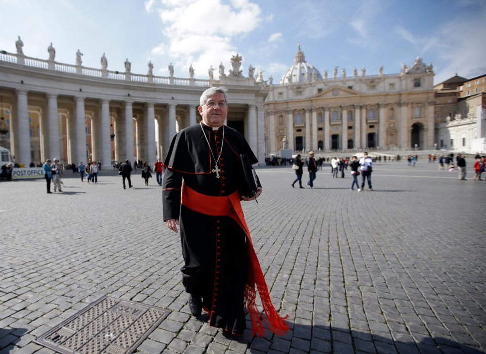 Canadian Cardinal Thomas Christopher Collins walks in St. Peter's Square after attending a cardinals' meeting, at the Vatican, Monday, March 4, 2013. (AP / Andrew Medichini)