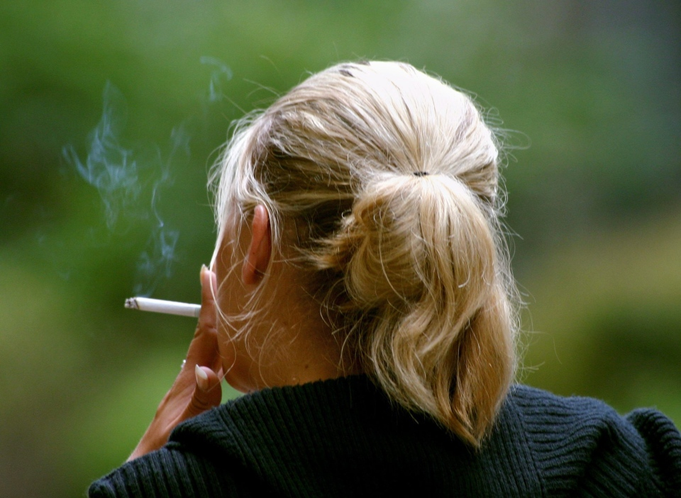 A woman smokes a cigarette during a break from work in downtown Chicago in this 2006 file photo. (AP Photo/Julio Cortez)