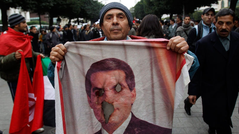 A protestor holds a burn picture of former Tunisian President Zine El Abidine Ben Ali during a demonstration in Tunis, Tuesday, Jan. 25. 2011. (AP / Christophe Ena)