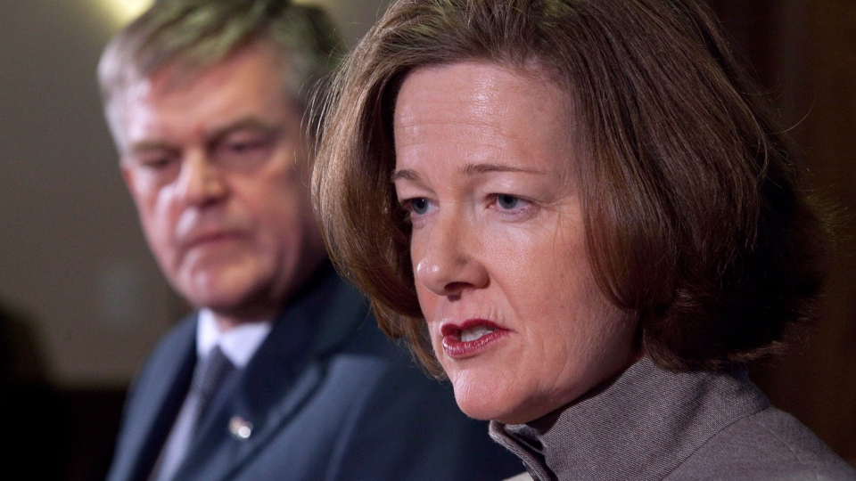 Alberta Premier Alison Redford, right, and New Brunswick Premier David Alward hold a joint news conference after meeting in Calgary, Alta., Tuesday, Feb. 5, 2013. (Jeff McIntosh / THE CANADIAN PRESS)