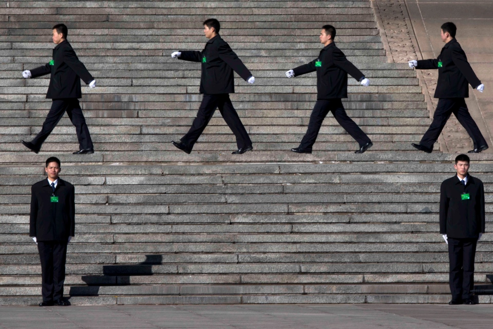 Chinese security personnel march outside the Great Hall of the People in Beijing, Monday, March 4, 2013. (AP / Ng Han Guan)