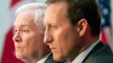 U.S Secretary of Defence Robert Gates and Defence Minister Peter MacKay listen to questions from members of the media following statements after their meeting in Ottawa on Thursday, January 27, 2011. (Pawel Dwulit / THE CANADIAN PRESS)