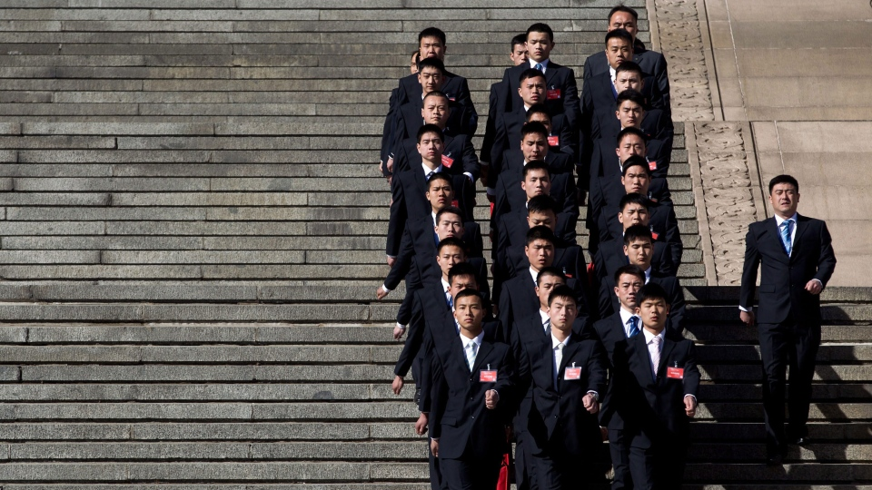 Chinese People's Liberation Army soldiers dressed as ushers march outside the Great Hall of the People after sessions of the National People's Congress and the Chinese People's Political Consultative Conference in Beijing Monday, March 4, 2013. (AP / Andy Wong)
