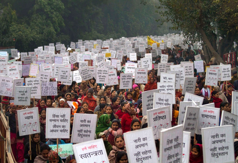 In this Wednesday, Jan. 2, 2013 file photo, Indian women carry placards as they march to mourn the death of a gang rape victim in New Delhi, India.  (AP Photo/Dar Yasin, File)