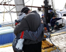Seal hunter Jocelyn Chiasson (right) is hugged by his daughter Sabrina, 11, after returning to the harbour at Cap-aux-Meule in Iles-de-la-Madeleine, Quebec, on Monday, March 31, 2008.  (Ryan Remiorz / THE CANADIAN PRESS)