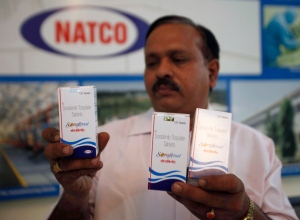 In this March 13, 2012 file photo, Natco Pharma Ltd. Secretary and General Manager Legal and Corp. Affairs M. Adinarayana displays Sorafenib Tosylate drugs meant for cancer treatment, at the company's head office in Hyderabad, India. (AP Photo/Mahesh Kumar A., File)