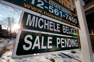 In this Saturday, Jan. 5, 2013, photo, a sale pending is outside a home in Mount Lebanon, Pa. (AP / Gene J. Puskar)