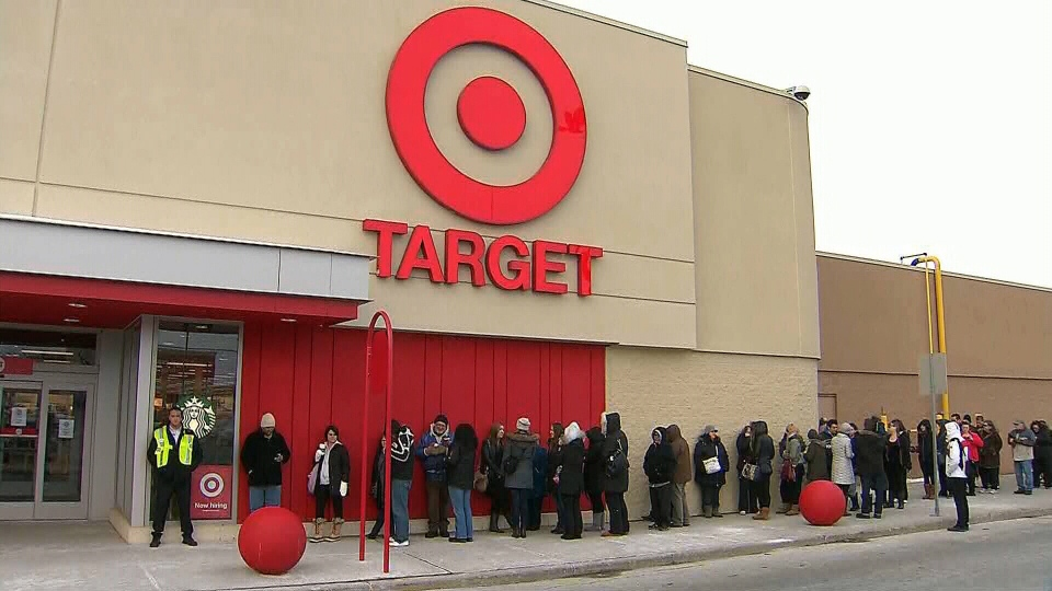 People begin to lineup outside for Target's grand opening in Milton, Ont., Tuesday, March 5, 2013.