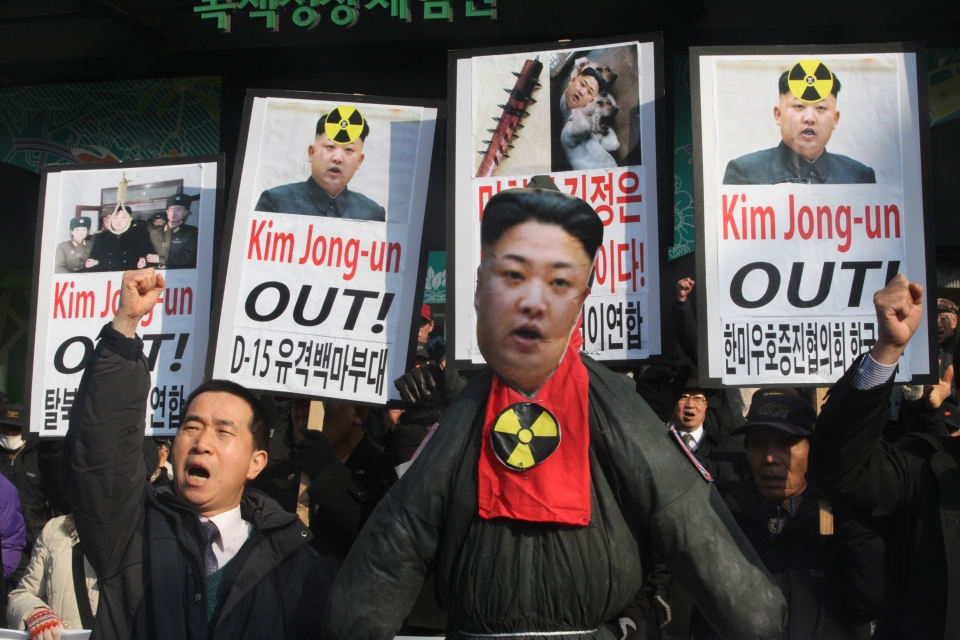 A South Korean protester shouts slogans near an effigy of North Korean leader Kim Jong Un during an anti-North Korea rally to denounce North Korea's nuclear test in Seoul, February 2013. (AP / Ahn Young-joon)