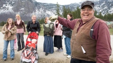 Winston Blackmore the religious leader of the polygamous community of Bountiful, B.C. shares a laugh with six of his daughters and some of his grandchildren, in this April 21, 2008 photo.(Jonathan Hayward / THE CANADIAN PRESS)