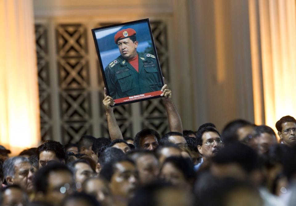 A man holds up an image of Venezuela's President Hugo Chavez during a demonstration in Managua, Nicaragua, Tuesday, March 5, 2013. (AP / Esteban Felix)
