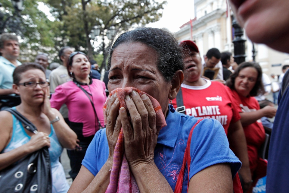 A supporter of Venezuela's President Hugo Chavez cries as she learns that Chavez has died through an announcement by the vice president in Caracas, Venezuela, Tuesday, March 5, 2013. (AP / Ariana Cubillos)