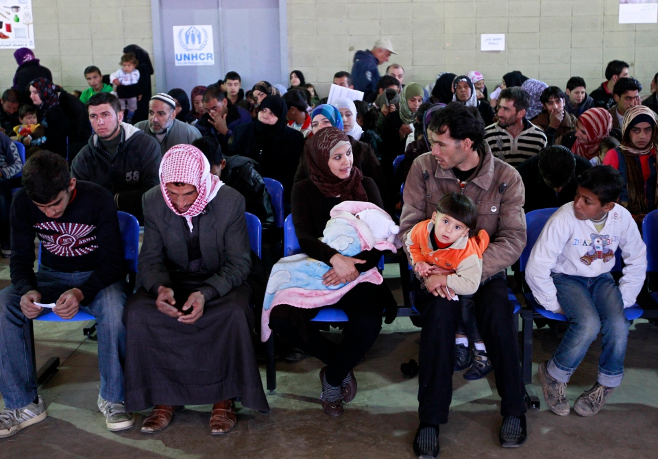 Syrian families wait their turn to register at the UNHCR center in the northern city of Tripoli, Lebanon, Wednesday, March. 6, 2013.  (AP / Bilal Hussein)