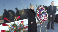 June Scobee Rodgers, left, widow of Dick Scobee, commander of space shuttle Challenger, and William Gerstenmaier, NASA Associate Administrator for Space Operations, place a wreath at the Space Mirror Memorial at a remembrance ceremony to mark the 25th Anniversary of space shuttle Challenger at the Kennedy Space Center visitor complex in Cape Canaveral, Fla., Friday, Jan. 28, 2011. (AP Photo/John Raoux)