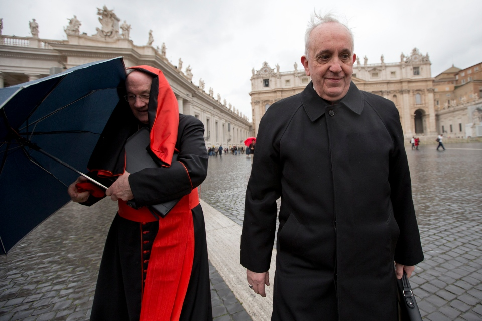 Canadian Cardinal Marc Ouellet, left, holds on to his umbrella next to Argentine Cardinal Jorge Mario Bergoglio as they walk in St. Peter's Square after attending a cardinals' meeting, at the Vatican, Wednesday, March 6, 2013. (AP / Andrew Medichini)