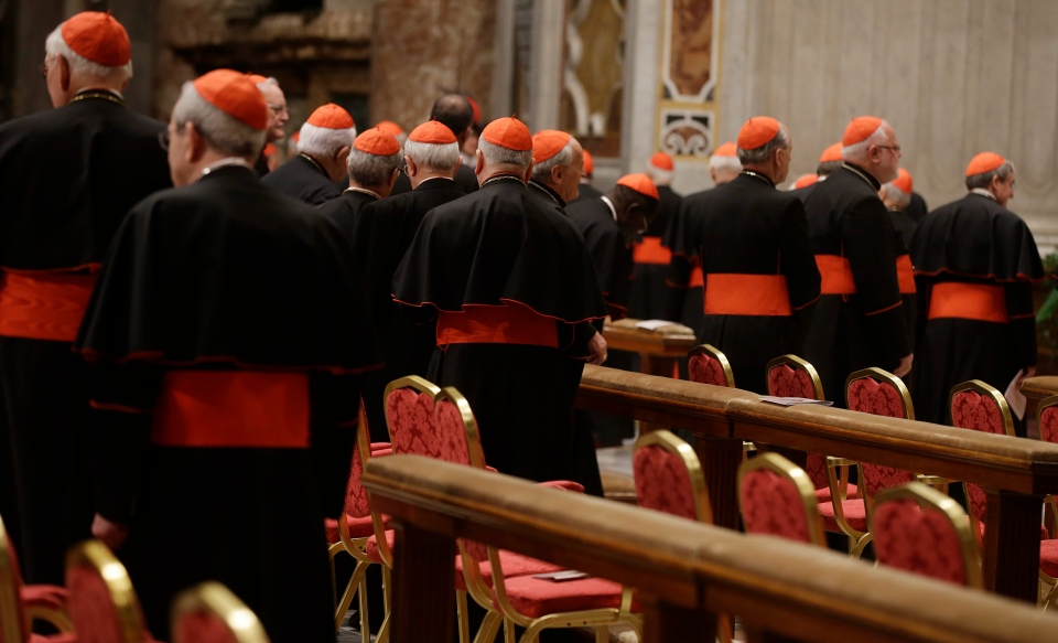 Cardinals leave at the end of a vespers celebration in St. Peter's Basilica at the Vatican, Wednesday, March 6, 2013. (AP / Gregorio Borgia)