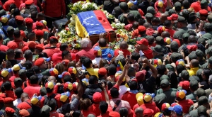 The flag-draped coffin containing the body of Venezuela's late President Hugo Chavez is taken from the hospital where he died, to a military academy where it will remain until his funeral in Caracas, Venezuela, Wednesday, March 6, 2013. (AP Photo/Ricardo Mazalan)