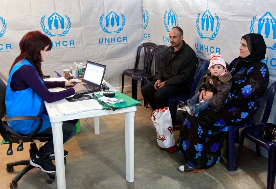 A Syrian family who fled their home from Aleppo register, at the UNHCR center in the northern city of Tripoli, Lebanon, Wednesday, March. 6, 2013. (AP / Bilal Hussein)