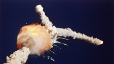 In this Jan. 28, 1986 file photo, the space shuttle Challenger explodes shortly after lifting off from the Kennedy Space Center in Cape Canaveral, Fla. (AP Photo/Bruce Weaver, File)