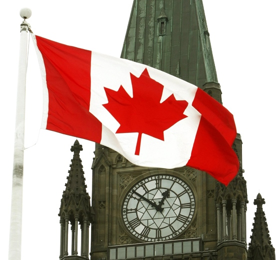 A Canadian flag flies on Parliament Hill in Ottawa on Tuesday April 1, 2008.  (Sean Kilpatrick  / THE CANADIAN PRESS)