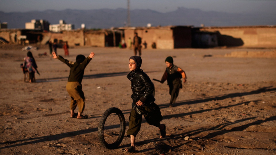Afghan refugee children play with tires on the outskirts of Islamabad, Pakistan, Friday, March 1, 2013. (AP / Muhammed Muheisen)
