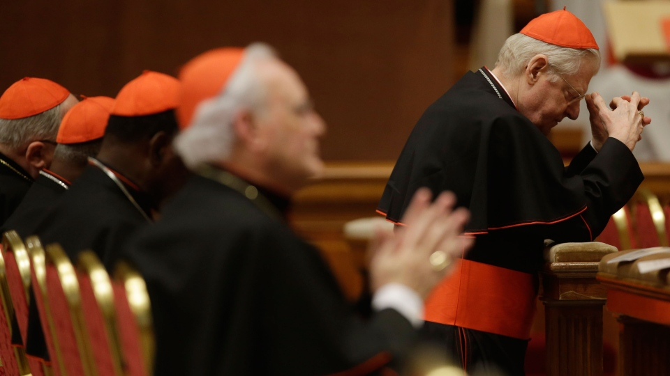 Cardinal Angelo Scola, top right, prays during a vespers celebration in St. Peter's Basilica at the Vatican, Wednesday, March 6, 2013. (AP / Gregorio Borgia)