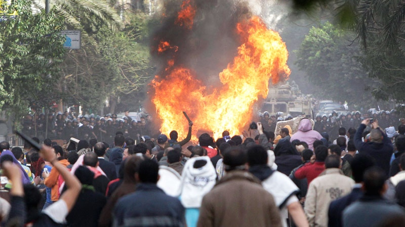 Protesters throw firebombs at riot police after police shot at protesters accompanying the funeral procession of an anti-government protester killed yesterday, in a street near Tahrir square in downtown Cairo, Egypt, Saturday, Jan. 29, 2011. (AP / Ben Curtis)