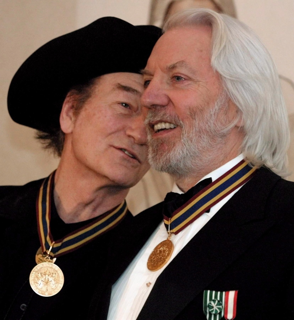 Stompin' Tom Connors (left) and actor Donald Sutherland both of Saint John, N.B., share a laugh following the Governor General's Performing Arts Award ceremony at Rideau Hall in Ottawa, Friday, Nov. 3, 2000. (Jonathan Hayward / THE CANADIAN PRESS)