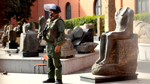 An Egyptian army soldier stands guard near antiquities at the Egyptian Museum in Cairo, Egypt, Saturday, Jan. 29, 2011. (AP / Amr Nabil)