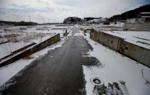 This Sunday, Feb. 24, 2013 photo shows an area devastated by the March 11, 2011 earthquake and tsunami, in Kesennuma, Miyagi Prefecture, northeastern Japan. (AP Photo/Junji Kurokawa)