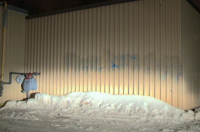 Remnants of spray-painted graffiti are seen on the Guelph Muslim Society's mosque in Guelph, Ont., on Wednesday, March 6, 2013. (CTV Kitchener)
