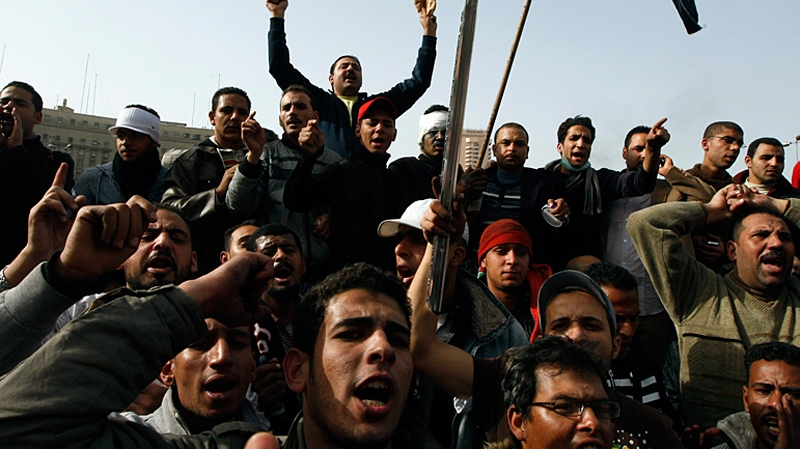 Egyptian protesters chant anti government slogans, in central Cairo, Egypt, Saturday, Jan. 29, 2011. (AP / Khalil Hamra)