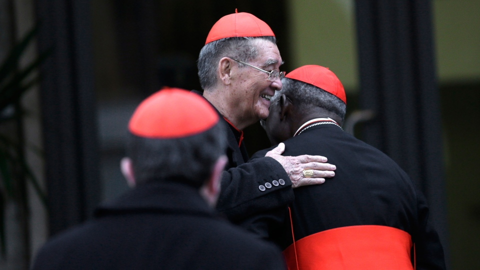 Vietnamese Cardinal Jean-Baptiste Pham Minh Man, centre, greets an unidentified cardinal as he arrives for a meeting, at the Vatican, Thursday, March 7, 2013. (AP / Alessandra Tarantino)
