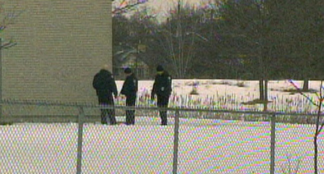 Police are shown at Thistletown Collegiate Institute on Thursday, March 7 after a shot was reportedly fired outside the school.