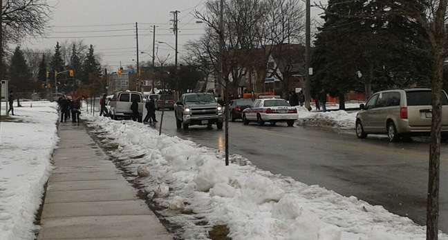 Police cruisers are shown at Thistletown Collegiate Institute after a shot was reportedly fired outside the school on March 7, 2013. (@jr_Armogan/Twitter)