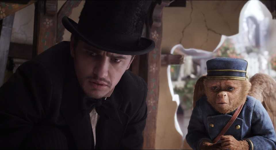 James Franco, as Oz, left, and the character Finley, voiced by Zach Braff, are shown in a scene from 'Oz the Great and Powerful'