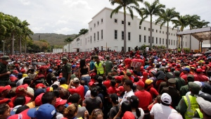 A crowd waits to enter the military academy where the body of Venezuela's late President Hugo Chavez lies in state in Caracas, Venezuela, Thursday, March 7, 2013. (AP / Ariana Cubillos)