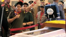 Long lines wait to see Chavez's coffin