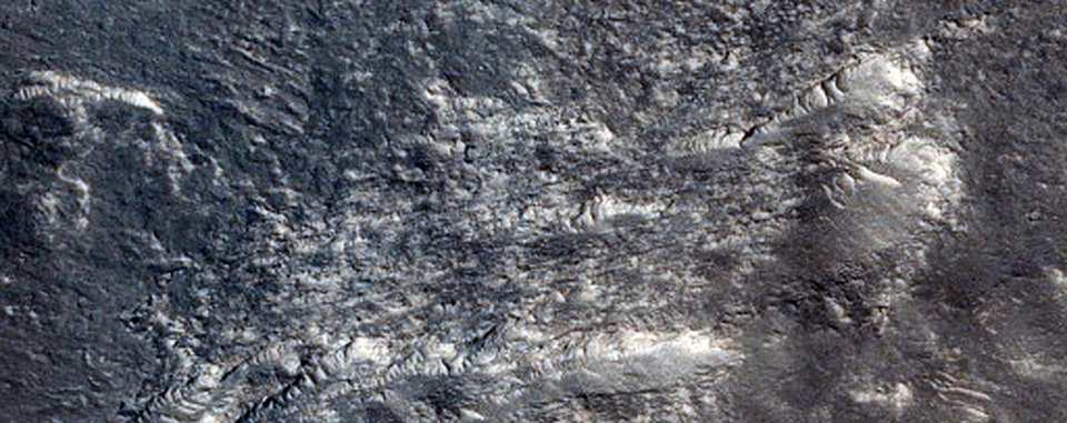 This image provided by NASA and taken by a camera aboard NASA's Mars Reconnaissance Orbiter shows the equatorial plains region known as Elysium Planitia on Mars. Using a radar instrument aboard the spacecraft, scientists made a 3-D map of flood channels below the surface of Mars, apparently created by past flooding. (AP Photo/NASA)