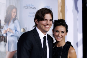 "Ashton Kutcher, left, and Demi Moore arrive at the premiere ""No Strings Attached"" in Los Angeles in this January 2011 file photo. (AP Photo/Matt Sayles)"