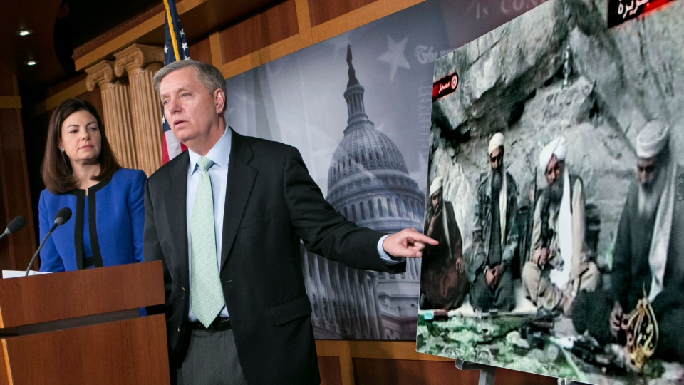 Sen. Lindsey Graham, R-S.C., accompanied by Sen. Kelly Ayotte, R-N.H., speaks to reporters on Capitol Hill In Washington, Thursday, March 7, 2013, about the capture of Osama Bin Laden's son-in-law Sulaiman Abu Ghaith. (AP / J. Scott Applewhite)