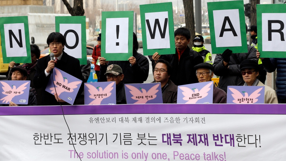 South Korean protesters hold signs during a press conference denouncing the UN's new sanction against North Korea, near the U.S. Embassy in Seoul, South Korea, Friday, March 8, 2013. (AP / Lee Jin-man)