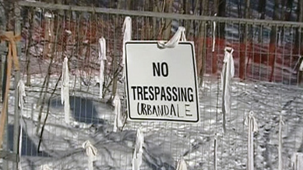 A gate blocks off property at the South March Highlands in Kanata, Monday, Jan. 31, 2011.