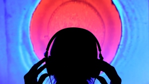 A man wears headphones  at an exhibit in Germany in this 2011 file photo. (AP Photo/Jens Meyer)