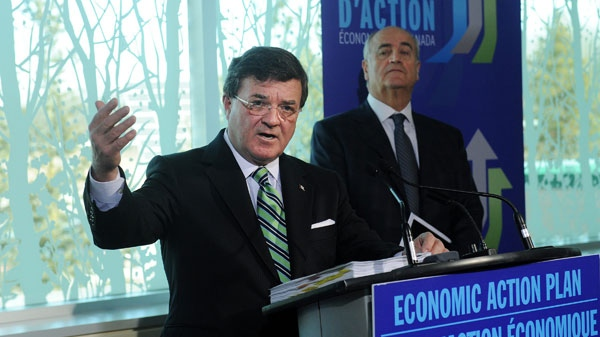 Finance Minister Jim Flaherty, left, speaks to the media as Minister of State Julian Fantino, right, listens during a press conference in Vaughan, Ont., on Monday, Jan. 31, 2011. (Nathan Denette / THE CANADIAN PRESS)